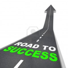 5599578-the-road-to-success--words-on-arrow-going-up