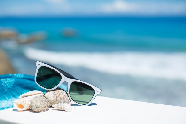 White-Sunglasses-And-Seashells-Blue-Sea-Summer-Vacation.jpg